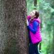 Attractive Caucasian woman hugging  a tree — Stock Photo