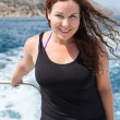 Smiling woman in sea cruise on ship — Stock Photo