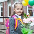 Stock Photo: Little schoolgirl portrait near her school