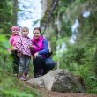 Mother with two small twins daughters in forest — Stock Photo #35157685