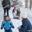 Family on a winter walk in forest — Stock Photo
