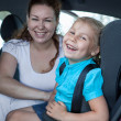 Mother with daughter in a car — Foto Stock