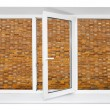 Plastic triple window with brick wall inside — Stock Photo #36163179