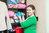 Woman and wardrobe closet — Stock Photo