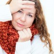 Diseased cold woman in a red scarf and sweater — Stock Photo