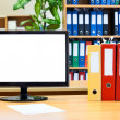Monitor screen and colored folders — Stock Photo