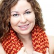 Head and shoulders portrait of young smiling curly haired woman — Stock Photo