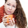 Young sick woman with a cup of tea in her hand — Stock Photo