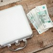 Stock Photo: Steel case and stack money