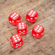 Dices on wooden floor — Stock Photo