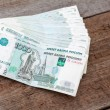 Stock Photo: Stack of Russimoney on floor