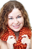 Facial portrait of young smiling curly haired woman with scarf — Stock Photo