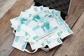 Steel case with money — Stock Photo