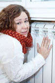 Woman feels cold sitting near central heating convector — Stock Photo