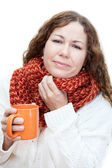 Ill woman holding a mug of tea — Stock Photo