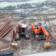 Excavators at dirty construction site — Stock Photo #38840647