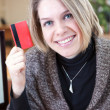Credit card in hand of young attractive woman — Stock Photo #40508683