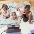 Three children looking at laptop — Foto Stock #40508695
