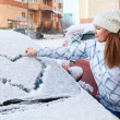 Woman drawing heart on car — Stock Photo #40508729