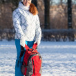 Foto de Stock  : Young womwith backpack in winter park