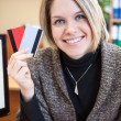 Woman holding two credit cards — Stock Photo