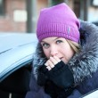 Pretty woman near a car — Stock Photo