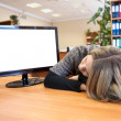 Young office worker sleeping at working place — Stockfoto #40509099