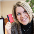 Credit card in hand of young attractive woman — Stock Photo