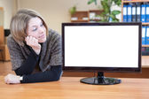 Girl near monitor — Stockfoto