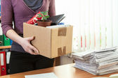 Office employee with box — Stock Photo