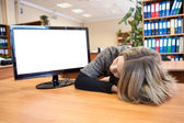 Young office worker sleeping at working place — Stockfoto