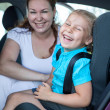 Family on back seat — Stock Photo #49588375