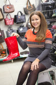 Woman showing waterboots — Stock Photo
