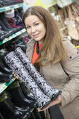 Customer with watertights — Stock Photo