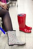 Buying rainboots — Stock Photo
