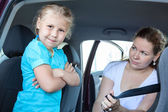 Child ignoring infant safety seat — Stock Photo