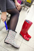 Woman trying waterboots — Stock Photo