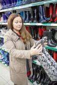 Woman looking at watertights — Stock Photo