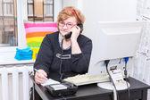 Senior woman at work — Stock Photo