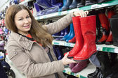 Customer with rubber boots — Stock Photo