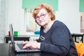 Senior woman with laptop — Stock Photo