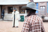 Two cowboys on street — Stock Photo