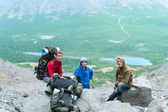 Mature father, mother and son hiking in mountains together — Stock Photo