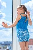 Child looking through window — Stock Photo