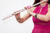 Woman plays on flute — Stock Photo