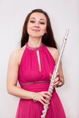 Woman with flute — Stock Photo