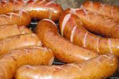 Mangal with sausage — Stock Photo