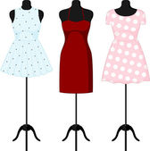 Different dresses on a mannequin. Vector — Stock Vector