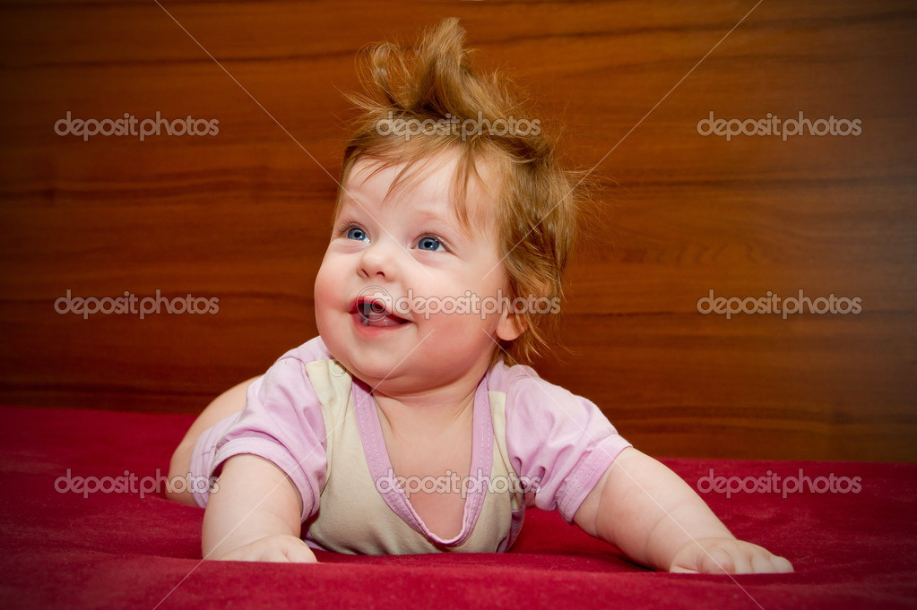 Cute funny baby girl with cheerful coiffure stock image