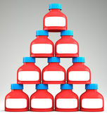 Pyramid of blank plastic containers — Stock Photo